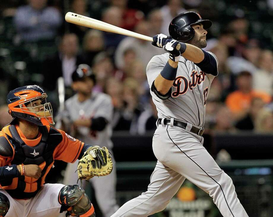 Alex Avila, right, had plenty to admire after delivering a ninth-inning homer, much to the chagrin of Astros catcher Carlos Corporan. Photo: Bob Levey, Stringer / 2013 Getty Images