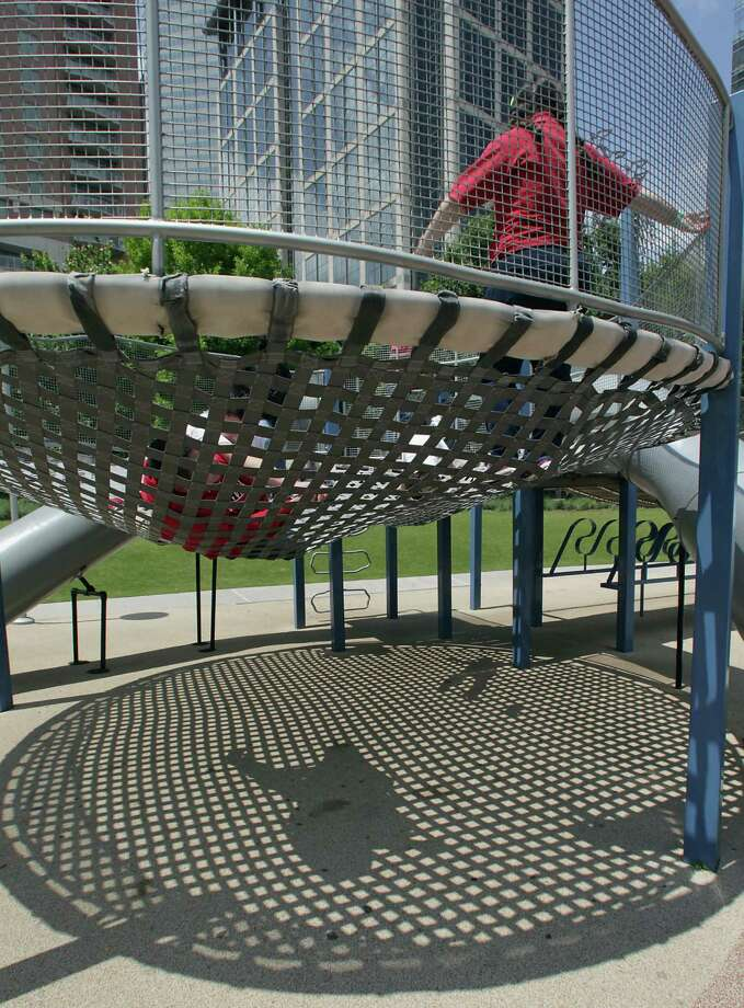 Playgrounds help attract families to Discovery Green. The park is holding special events to commemorate its fifth anniversary. Photo: James Nielsen, Staff / © 2013 Houston Chronicle