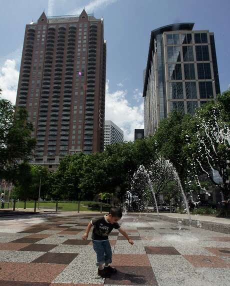 "Trees and a hill were intended as protective barriers between Discovery Green and La Branch and McKinney Streets. In 2008, when the park opened, it was surrounded by fast-moving traffic. ""That space doesn't need to be contained anymore,"" says landscape designer Mary Margaret Jones. Photo: James Nielsen, Staff / © 2013 Houston Chronicle"
