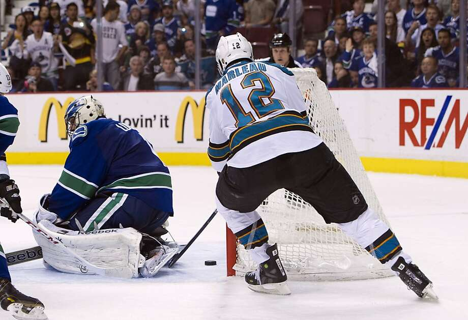 Patrick Marleau forced overtime by tapping in a loose puck behind goalie Roberto Luongo in the last minute of regulation. Photo: Rich Lam, Getty Images