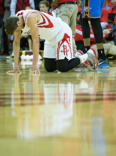 Rockets small forward Chandler Parsons is slow to get up after a collision with Thunder small forwar