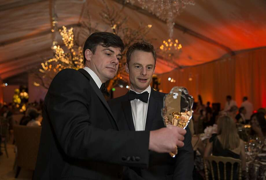 James Buckhouse (left) shows choreographer Christopher Wheeldon a special Twitter mirror during the San Francisco Ballet's Cinderella Opening Night Ball in a tent outside War Memorial Opera House in San Francisco, Calif., on Friday, May 3, 2013.  The party celebrated the opening night and United States premiere of Wheeldon's production of Cinderella. Photo: Laura Morton, Special To The Chronicle