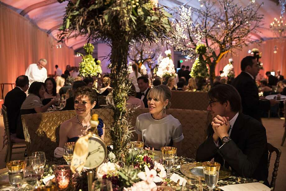 Denise Littlefield Sobel, Christine Suppes and Paul Wattis (left to right) eat dinner in at tent outside War Memorial Opera House while attending San Francisco Ballet's Cinderella Opening Night Ball in San Francisco, Calif., on Friday, May 3, 2013.  The party celebrated the opening night and United States premiere of choreographer Christopher Wheeldon's production of Cinderella. Photo: Laura Morton, Special To The Chronicle