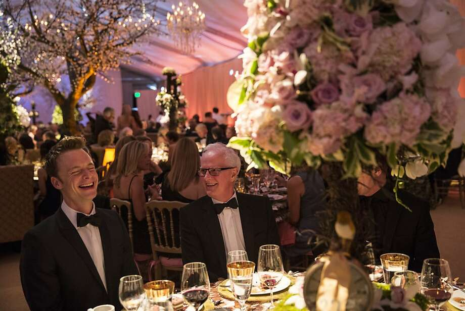 Choreographer Christopher Wheeldon (left) and San Francisco Ballet Artistic Director Helgi Tomasson share a laugh during dinner at the Cinderella Opening Night Ball in a tent outside War Memorial Opera House in San Francisco, Calif., on Friday, May 3, 2013.  The party celebrated the opening night and United States premiere of Wheeldon's production of Cinderella. Photo: Laura Morton, Special To The Chronicle
