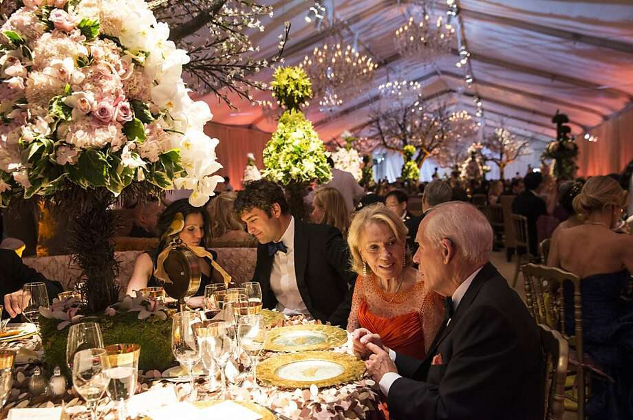 Sloan Barnett, Zachary Bogue, Charlottle Shultz and Gary Shansby (left to right) sit down to dinner while attending San Francisco Ballet's Cinderella Opening Night Ball in a tent outside War Memorial Opera House in San Francisco, Calif., on Friday, May 3, 2013.  The party celebrated the opening night and United States premiere of choreographer Christopher Wheeldon's production of Cinderella. Photo: Laura Morton, Special To The Chronicle