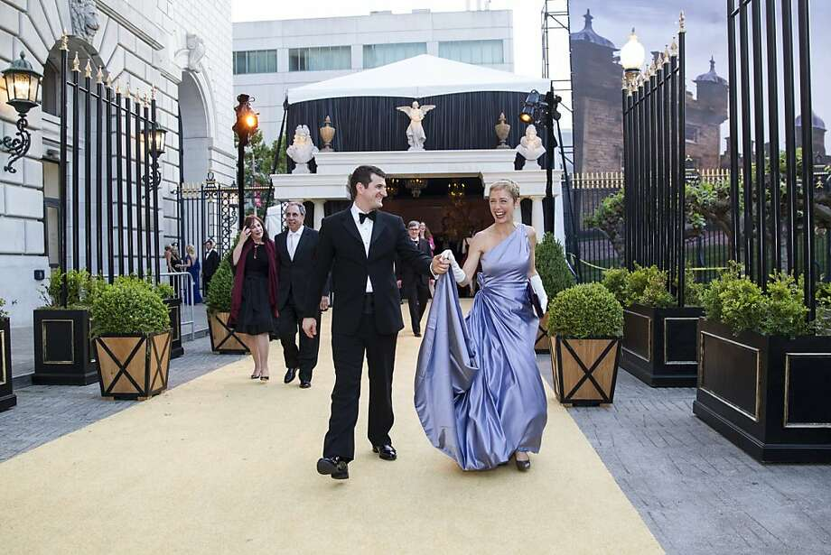 Jason Crethar (left) and Larissa Roesch walk to the performance after dinner while attending San Francisco Ballet's Cinderella Opening Night Ball at War Memorial Opera House in San Francisco, Calif., on Friday, May 3, 2013.  The party celebrated the opening night and United States premiere of choreographer Christopher Wheeldon's production of Cinderella. Photo: Laura Morton, Special To The Chronicle