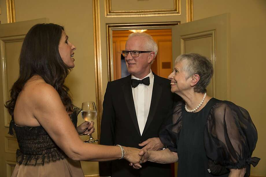 Lisa Grotts greets San Francisco Ballet Artistic Director Helgi Tomasson and his wife Marlene Tomasson (left to right) during a performance intermission at the Cinderella Opening Night Ball at War Memorial Opera House in San Francisco, Calif., on Friday, May 3, 2013.  The party celebrated the opening night and United States premiere of choreographer Christopher Wheeldon's production of Cinderella. Photo: Laura Morton, Special To The Chronicle