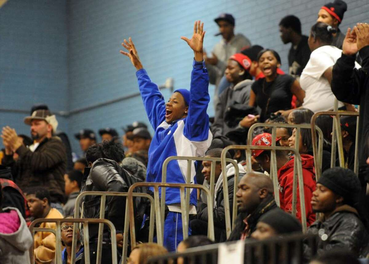 A Harding fan celebrates a score, during basketball action against Stamford in Bridgeport, Conn. on Friday Jan. 08, 2009.