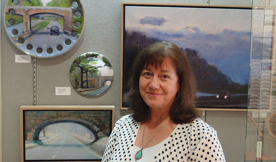 Artist Cynthia Mullins with some of her paintings depicting scenes along the Merritt Parkway, part of a new exhibit on the parkway's 75th anniversary at the Westport Public Library.  WESTPORT NEWS, CT 5/3/13 Photo: Mike Lauterborn / Westport News contributed