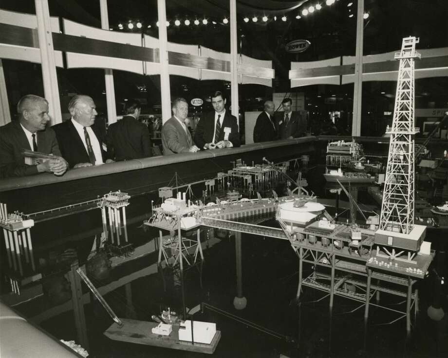 1971 - Attendees at the third annual Offshore Technology Conference gathered around an elaborate display of miniature marine drilling platforms, process facilities and derrick barges in the Halliburton exhibit. The three-day conference, was held in the Astrohall, attracting about 5,000 registrants on opening day. Photo: Fred Bunch, Houston Chronicle