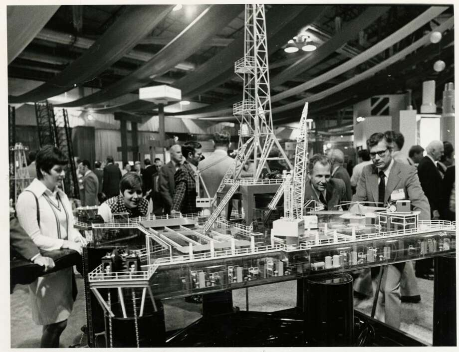 1974 - Offshore Technology Conference attendees take a closer look at a platform model in the Astrohall. Photo: Fred Bunch, Houston Chronicle