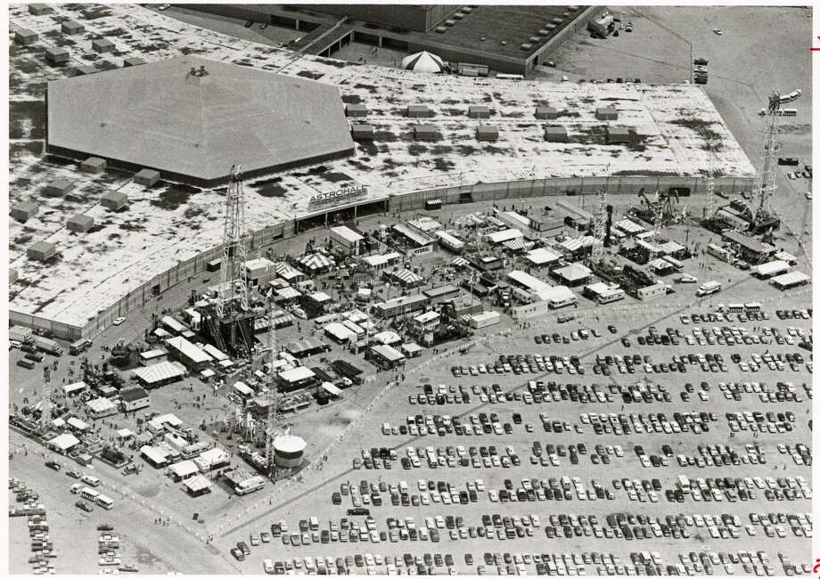 1982 - More than 108,000 engineers, scientists and exploration managers were expected to file through the Astrodomain by the time the 14th annual Offshore Technology Conference completed its four-day stay. Exhibits overflowed out of the Astrohall in this photo taken during a helicopter ride owned by Bell Helicopter Textron. Photo: Darrell Davidson, Houston Chronicle