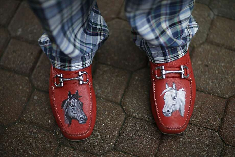 James Cowheard, from Las Vegas, Nev., shows off his fancy shoes before the running of the 139th Kentucky Derby at Churchill Downs Saturday, May 4, 2013, in Louisville, Ky. (AP Photo/David Goldman) Photo: David Goldman, Associated Press