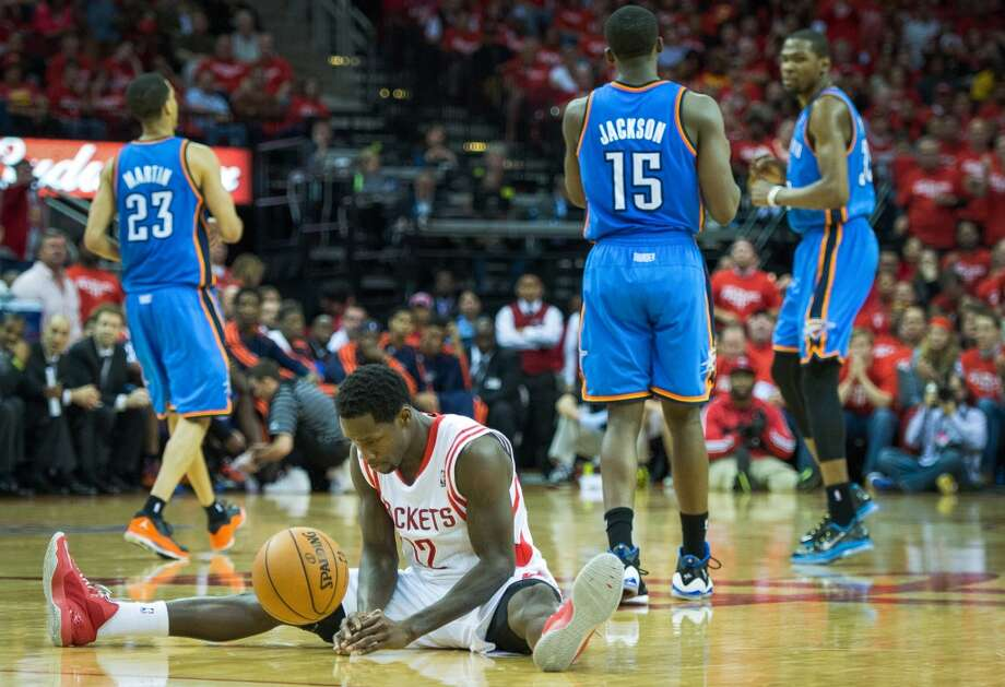 As econd-half Thunder surge erased a10-point Rockets lead and left point guard PatrickBeverley(12) and his teammates wondering what might have been Friday. Photo: Smiley N. Pool, Houston Chronicle