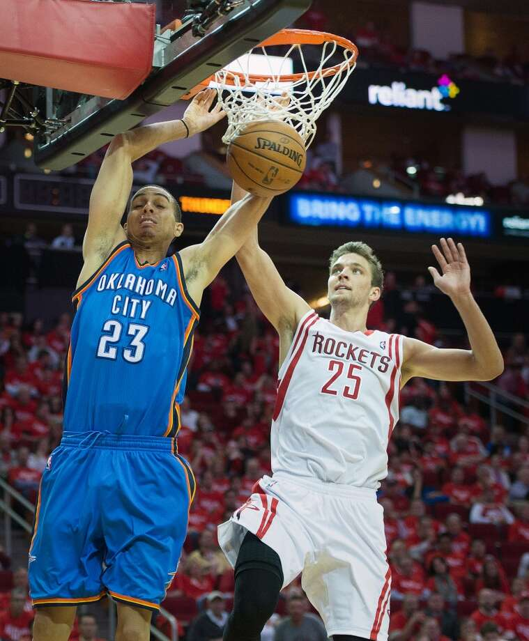 Thunder guard Kevin Martin made his former team pay with 25 points Friday, including slamming home two past the Rockets' Chandler Parsons. Photo: Smiley N. Pool, Houston Chronicle