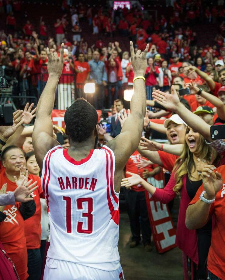 Rockets shooting guard James Harden leaves the court to the cheers of the crowd after the final game of his first season in Houston. Photo: Smiley N. Pool, Houston Chronicle
