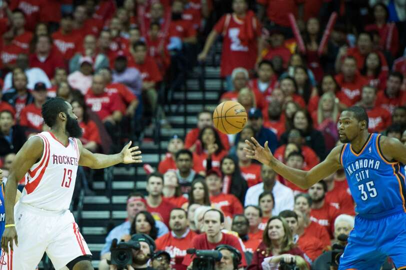 Thunder forward Kevin Durant (35) is the recipient of a turnover by Rockets shooting guard James Har