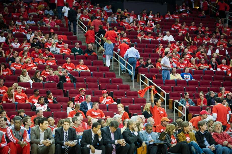 Rockets fans head for the exits during the fourth quarter of the loss to the Thunder. Photo: Smiley N. Pool, Houston Chronicle