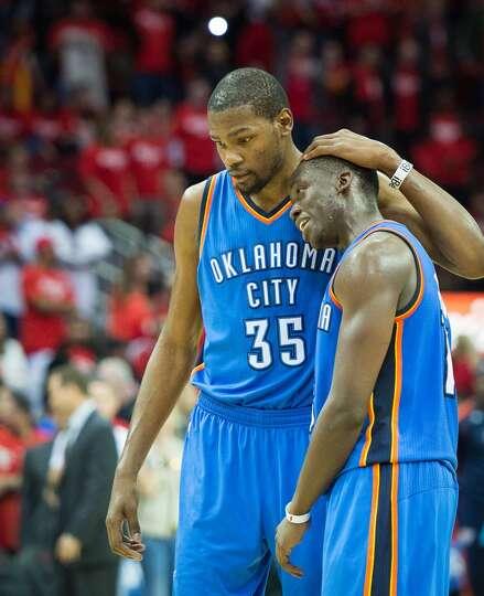 Thunder small forward Kevin Durant (35) hugs point guard Reggie Jackson during the fourth quarter.