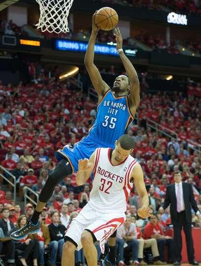 Kevin Durant dunks over Rockets shooting guard Francisco Garcia.