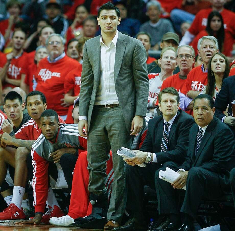 Rockets guard Carlos Delfino looks on from the bench during the first half. Playing with a sore right foot for several weeks, Delfino believes he aggravated the injury on the dunk, an injury that will require surgery to repair a bone fracture. Photo: James Nielsen, Houston Chronicle