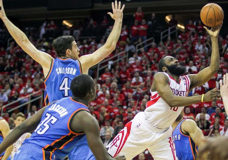 ames Harden right, drives past Nick Collison.