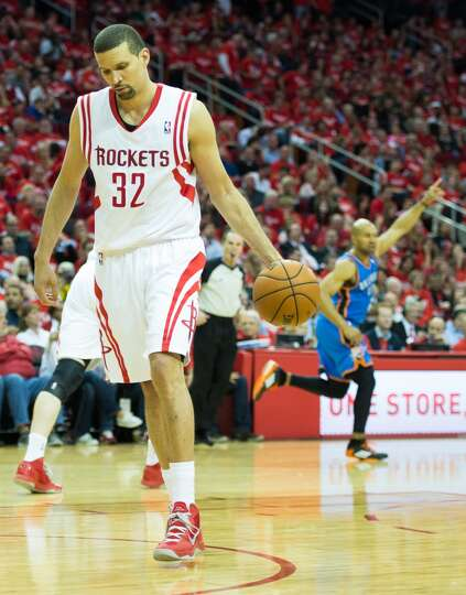 Rockets guard Francisco Garcia picks up the ball after a 3-pointer by Thunder point guard Derek Fish