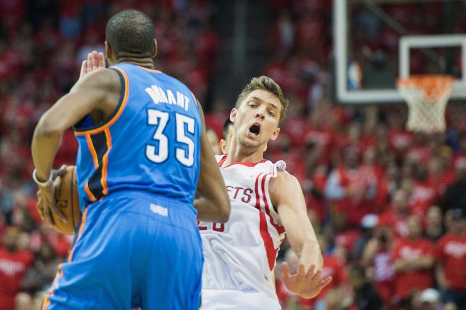 Rockets forward Chandler Parsons, right, went down hard at the end of the half after a collision with the ThunderÕs Kevin Durant (35), but no foul was called and Oklahoma City took a four-point lead into the break. Photo: Smiley N. Pool, Houston Chronicle