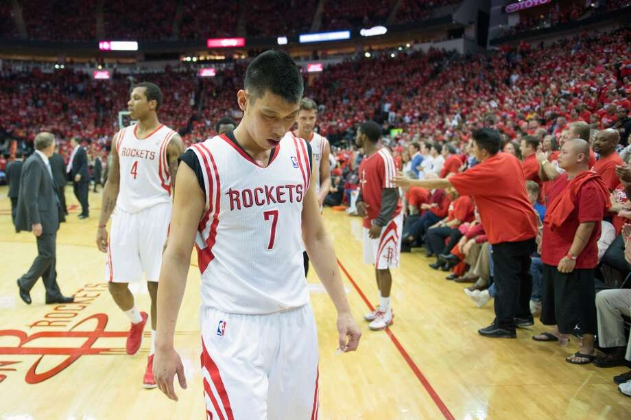 Rockets point guard Jeremy Lin walks off the court at the end of the first half. Photo: Smiley N. Pool, Houston Chronicle