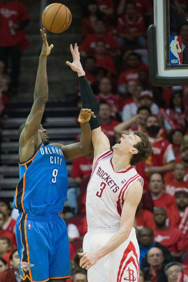 City Thunder power forward Serge Ibaka shoots over Rockets center Omer Asik. Photo: Smiley N. Pool, Houston Chronicle