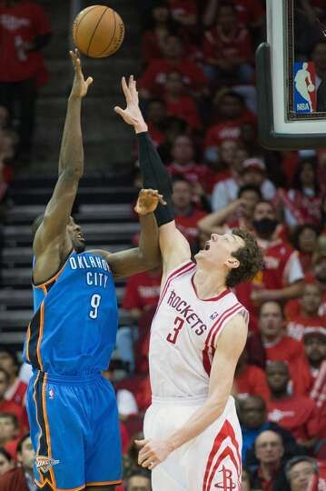 City Thunder power forward Serge Ibaka shoots over Rockets center Omer Asik.