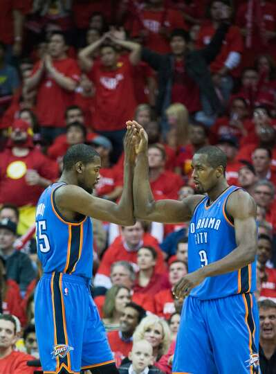 Thunder small forward Kevin Durant (35) celebrates with power forward Serge Ibaka.