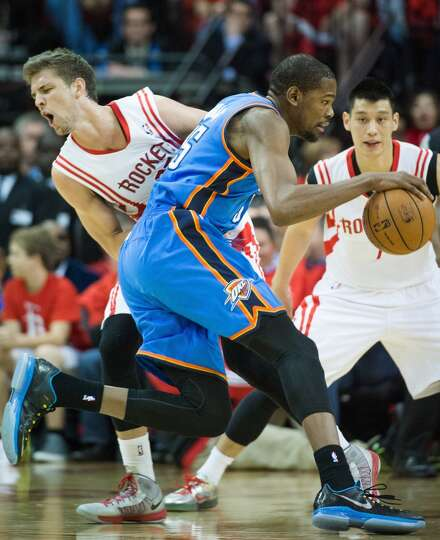 Rockets forward Chandler Parsons is knocked to the floor by Thunder forward Kevin Durant.