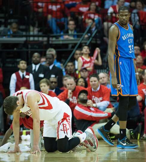 Rockets forward Chandler Parsons is slow to get up after a collision with Thunder forward Kevin Dura