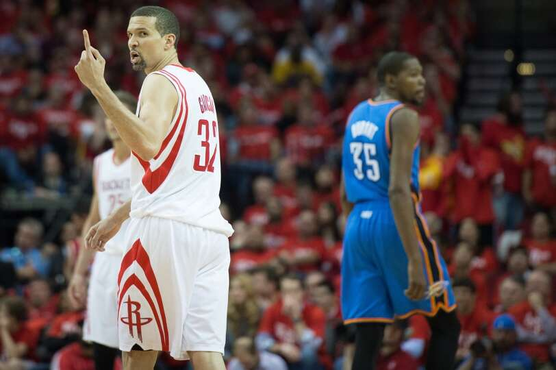 Rockets shooting guard Francisco Garcia holds up one finger as he looks toward a Thunder player.