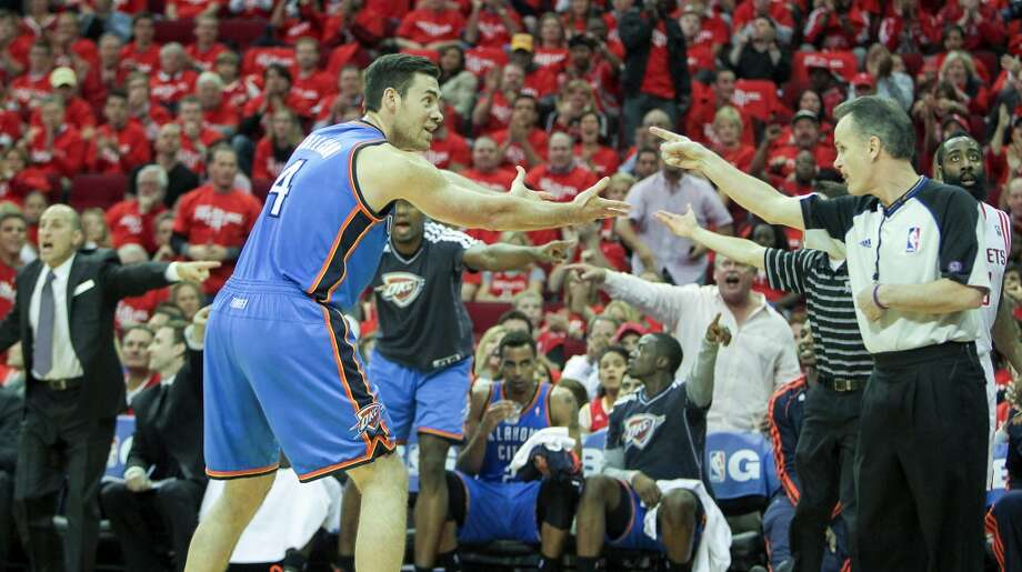 Thunder power forward Nick Collison disagrees on a call by NBA official Mike Callahan. Photo: James Nielsen, Houston Chronicle
