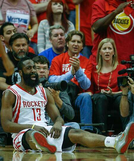 Rockets guard James Harden is knocked to the floor.