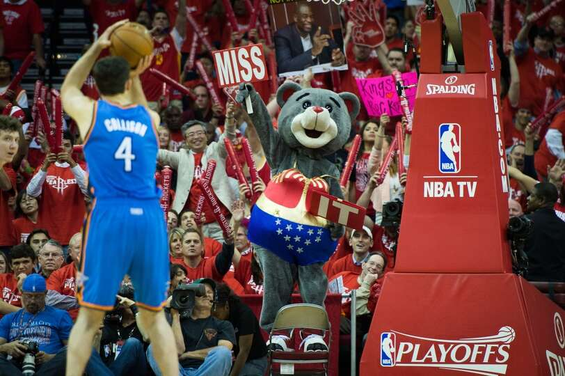 Rockets mascot Clutch tries to distract Thunder power forward Nick Collison as he shoots a foul shot