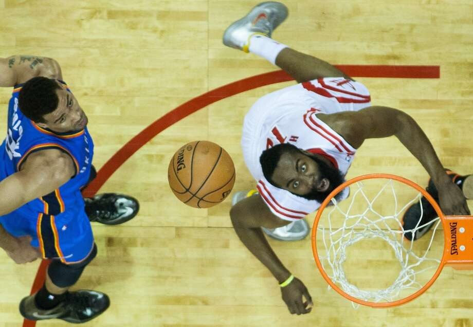 Rockets shooting guard James Harden watches as his shot bounces off the rim after getting past the Thunder's Thabo Sefolosha. Photo: Smiley N. Pool, Houston Chronicle
