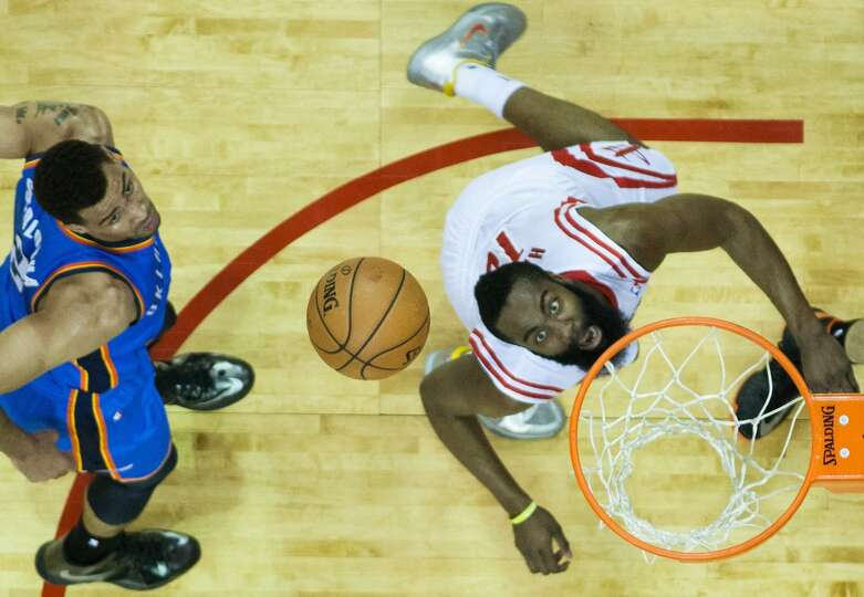 Rockets shooting guard James Harden watches as his shot bounces off the rim after getting past the T