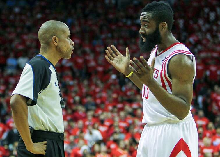 Rockets guard James Harden speaks with referee Sean Corbin.