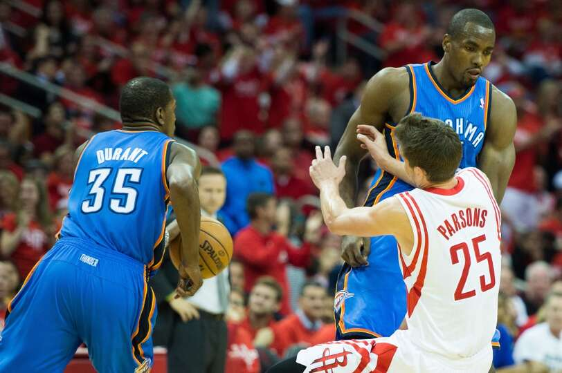 Rockets forward Chandler Parsons is knocked to the floor by a pick from Thunder power forward Serge