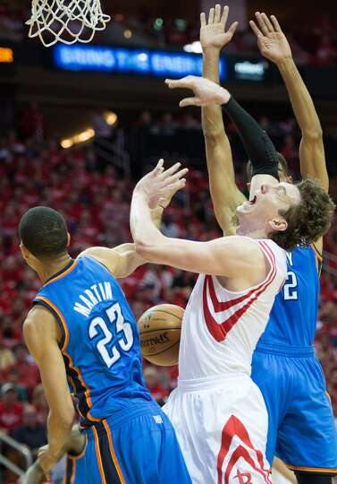 Rockets center Omer Asik has the ball knocked away buy Thunder guard Kevin Martin.