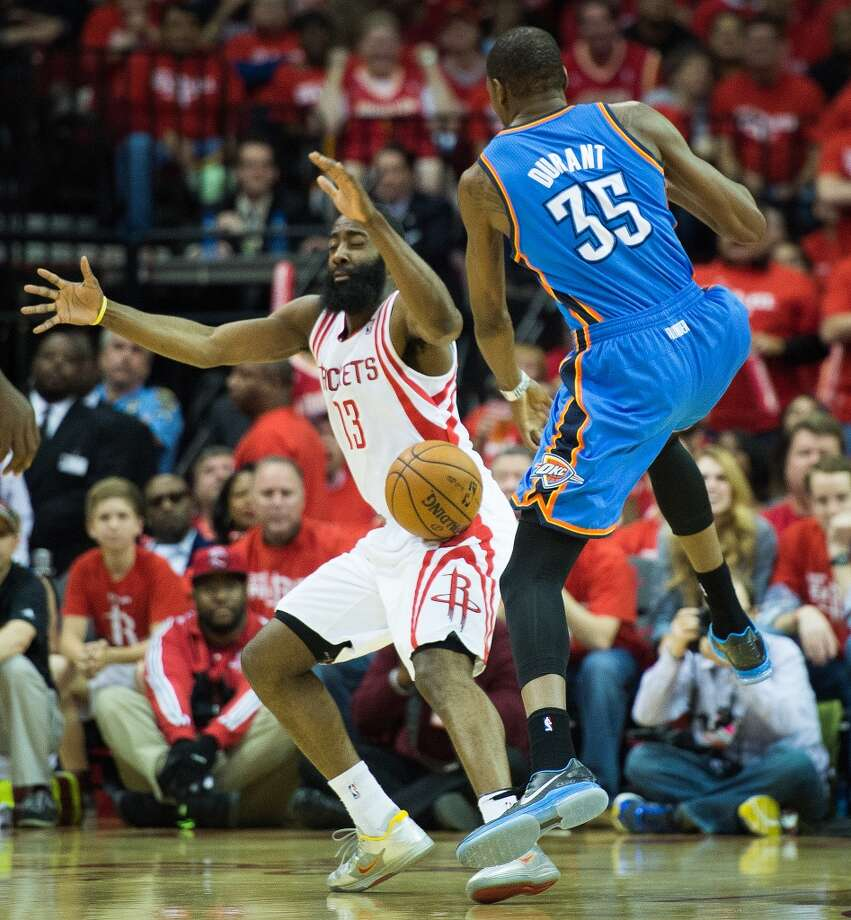 Thunder forward Kevin Durant loses the ball as Rockets guard James Harden defends. Photo: Smiley N. Pool, Houston Chronicle