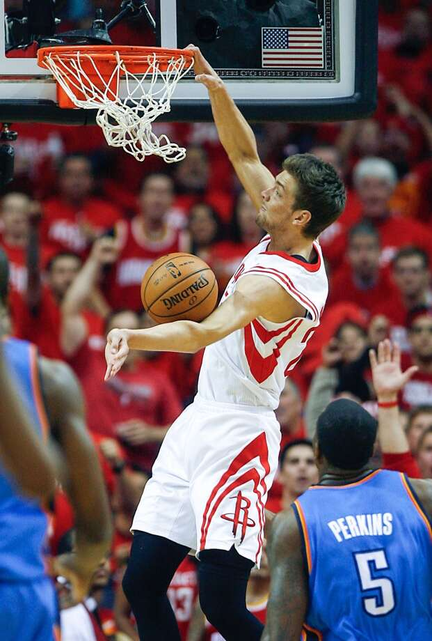 Rockets small forward Chandler Parsons dunks past Thunder center Kendrick Perkins. Photo: James Nielsen, Houston Chronicle