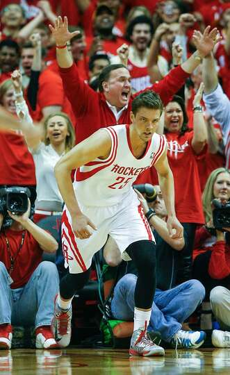 Fans react after a basket by the Rockets' Chandler Parsons.