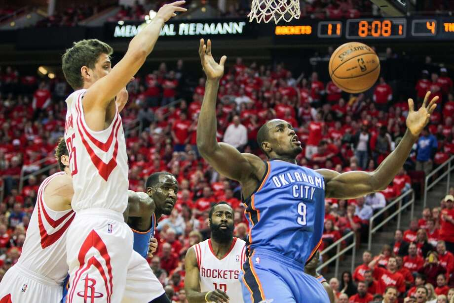 Rockets forward Chandler Parsons andThunder forward Serge Ibaka chase a rebound. Photo: James Nielsen, Houston Chronicle