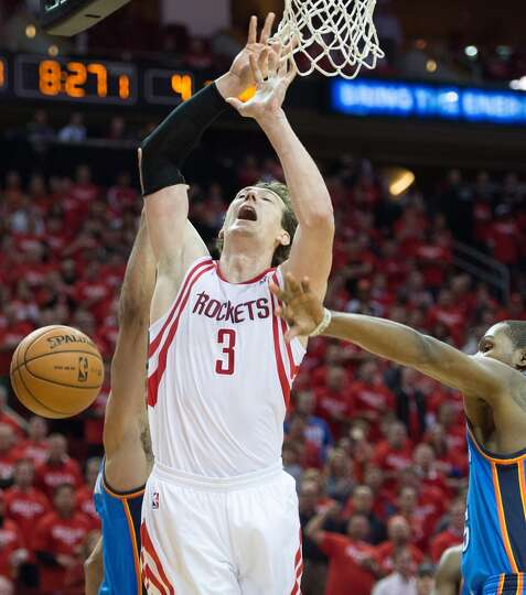Rockets center Omer Asik has the ball knock away by Thunder forward Kevin Durant.