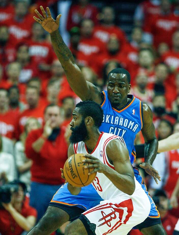 Rockets shooting guard James Harden tries to get past Thunder center Kendrick Perkins. Photo: James Nielsen, Houston Chronicle