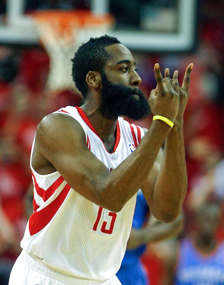 Rockets shooting guard James Harden reacts after scoring a basket. Photo: James Nielsen, Houston Chronicle